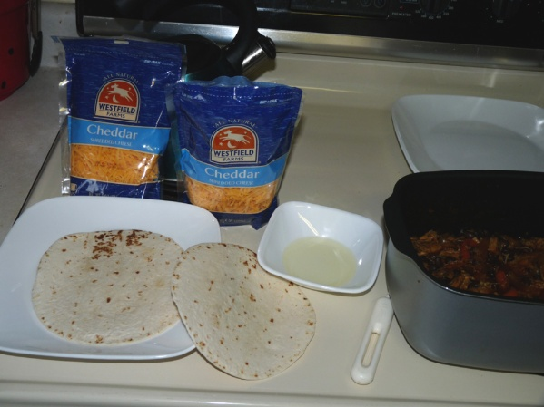 Brush the bottom of the first tortilla with oil