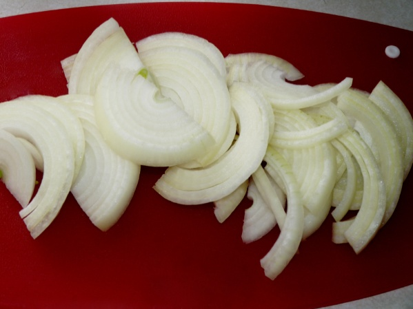 Cut an onion in half, then in thin slices