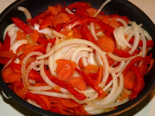Saute onions, carrots and red peppers
