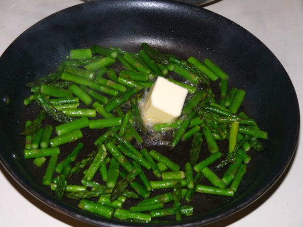 Saute asparagus 2-3 minutes in a drizzle of oil,then add 2 tablespoons butter