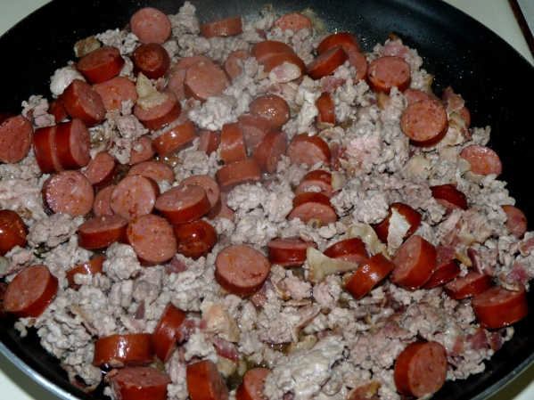 Add andouille sausage and fry until it is browned