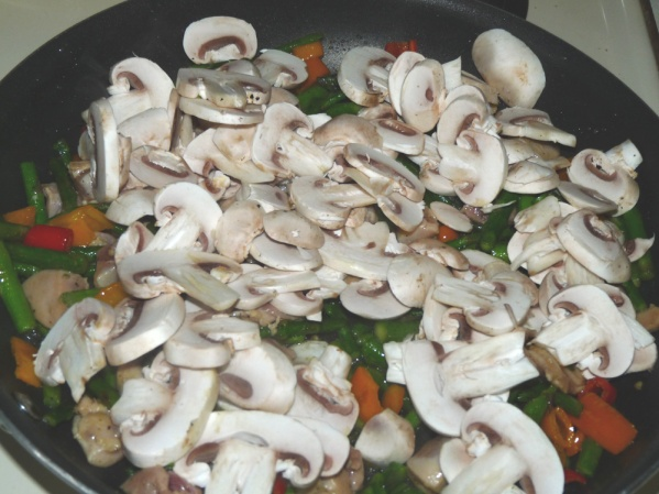 Add mushrooms and sauté several more minutes