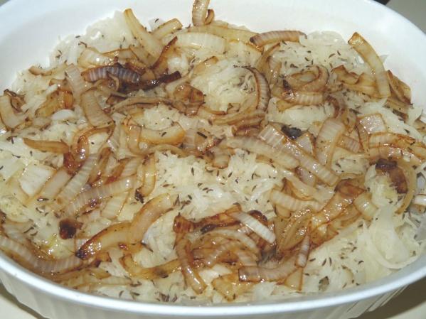 Layer chops, sauerkraut, caraway, onions