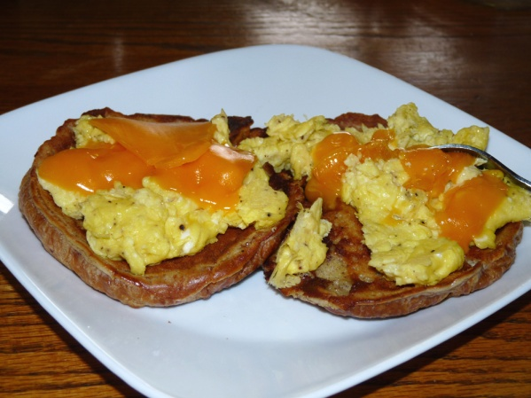French Toast Croissants topped with scrambled eggs and cheddar cheese