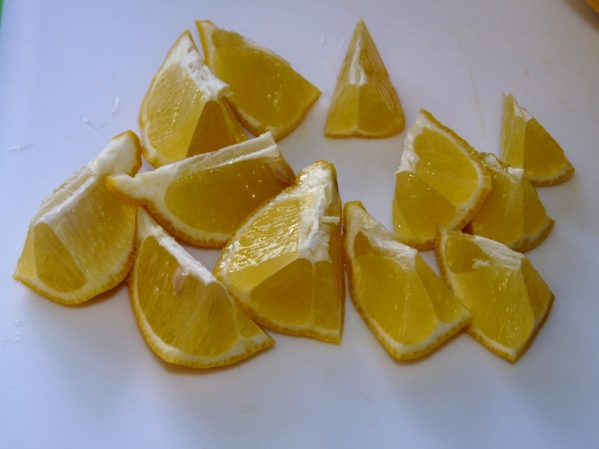 Cut lemon into chunks and add to pot