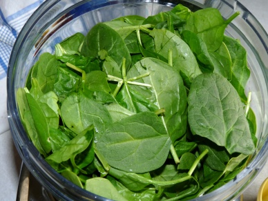 Load the spinach leaves into a food processor