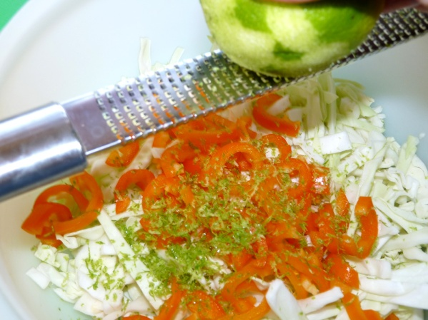 Cut cabbage and peppers into fine strips. Zest one lime.