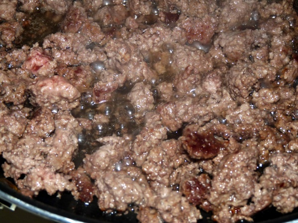 Fry ground beef until browned