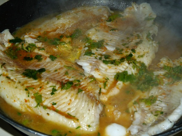 Add sauce and simmer until fish is flaky