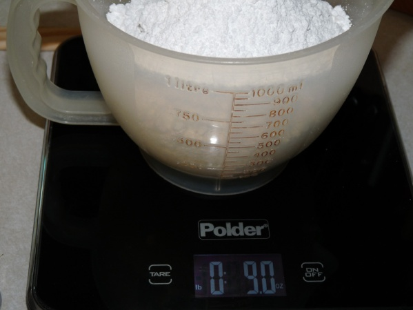 Measure 9 ounces of powdered sugar
