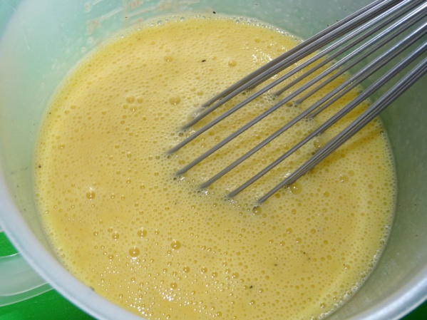 Whisk together eggs, milk, cream, dry mustard, salt and pepper