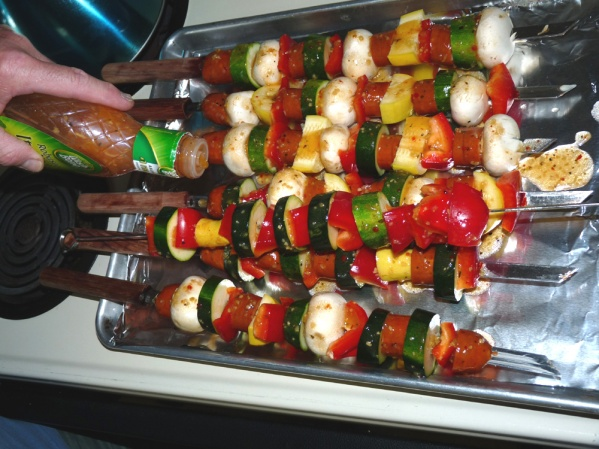 Pour or brush Italian dressing over the skewers