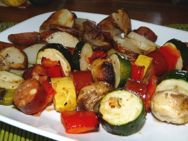 Grilled sausage skewers and potatoes