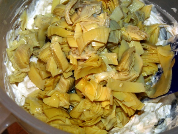 Stir in chopped artichoke hearts