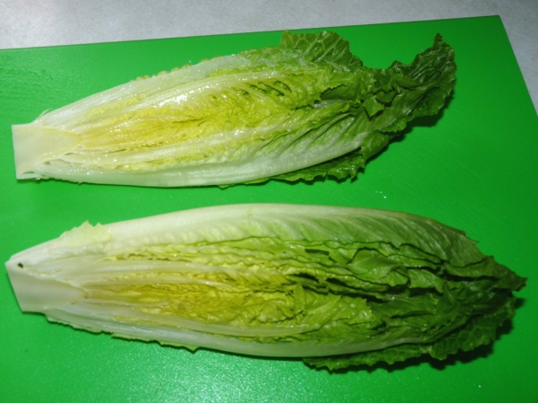 Cut Romaine hearts in half lengthwise