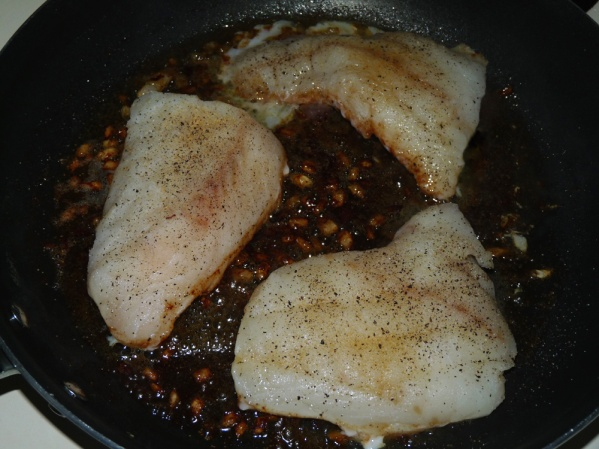 Add cod to skillet over onions, butter and wine
