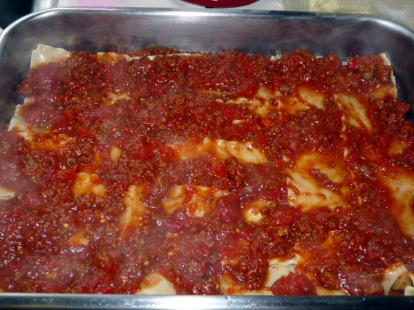 Add a layer of noodles, then a layer of meat sauce