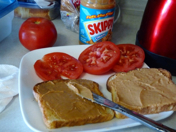 Spread peanut butter on both sides of the toast.  Cover with tomato slices.