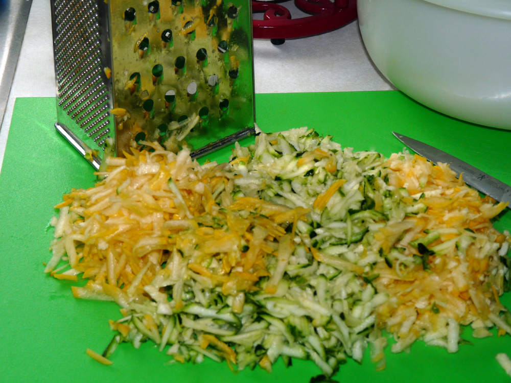 Shred 2 cups of zucchini and summer squash