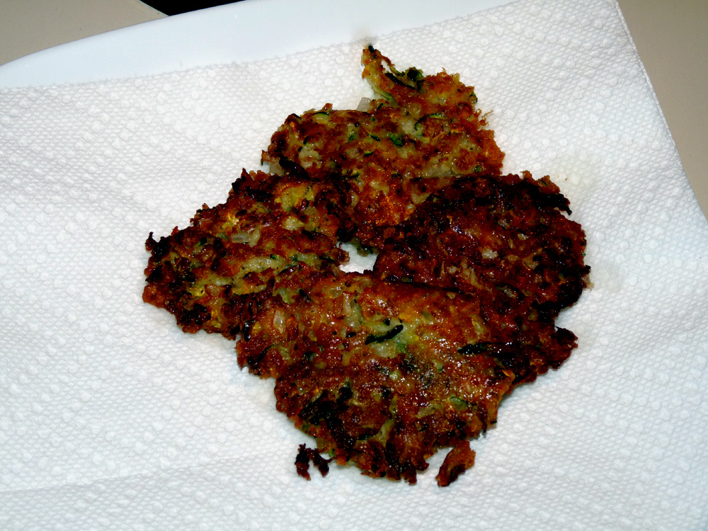 Place on twoelling while continuing to fry more fritters
