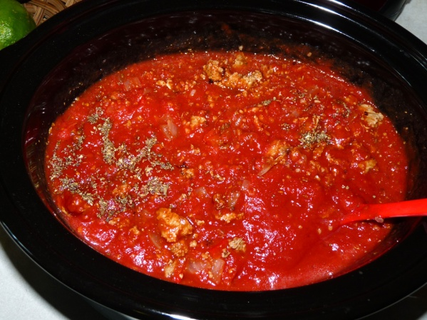 Add tomatoes and tomato sauce to crockpot with the meat mixture