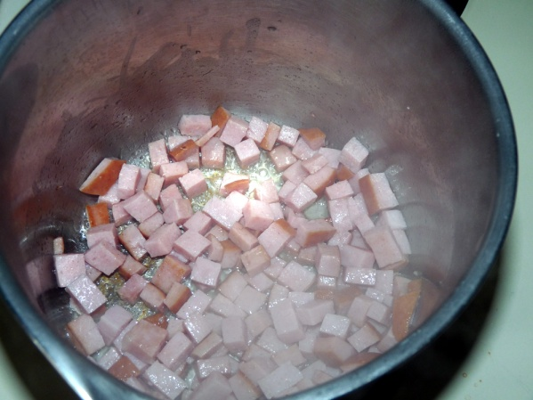 Dice ham and add to large saucepan. Saute with bacon grease