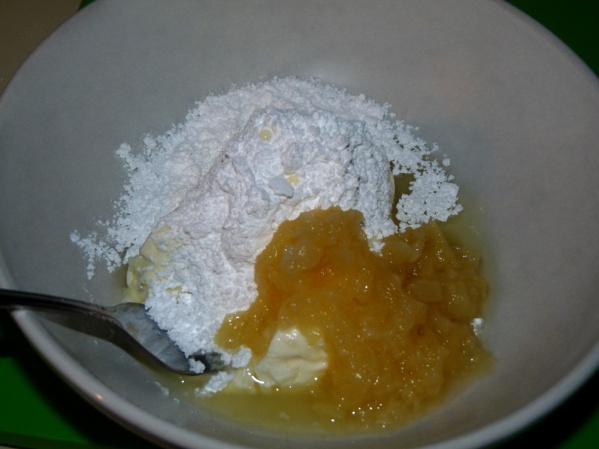 Stir together melted cream cheese, crushed pineapple and powdered sugar