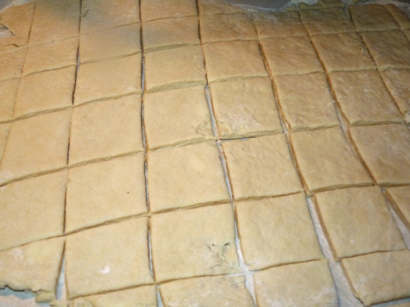 """Roll dough to 1/2"""" thickness and cut into squares"""