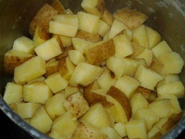 Boil potatoes until very soft then drain