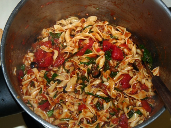 Add chopped spinach, diced tomatoes black olives and seasonings of choice