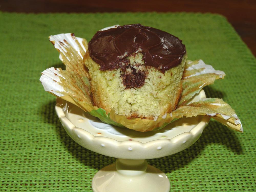Chocolate Filled Pistachio Cupcakes