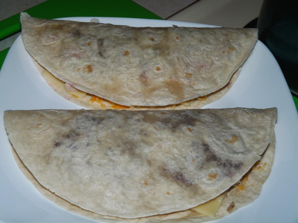 Fold tortillas in half