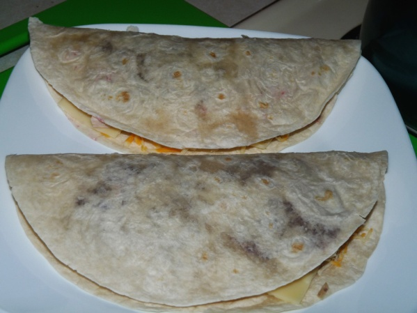 Fold tortillas in half