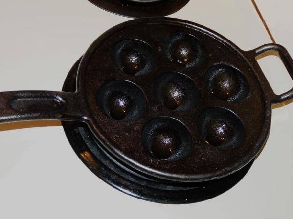 Thoroughly heat a cast iron aebleskiver griddle