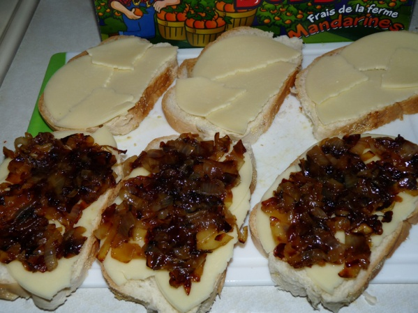 Layer provolone then spread with caramelized onions