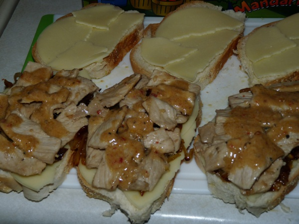 Layer pork slices and drizzle with reduced sauce