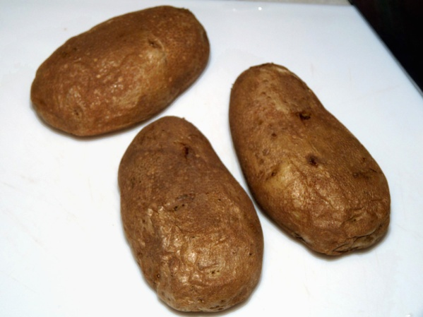 Scrub and microwave potatoes until softened