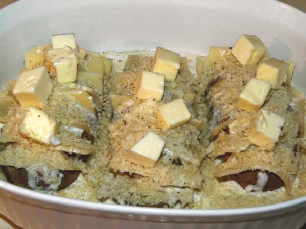 Cut the butter into chunks and place over potatoes