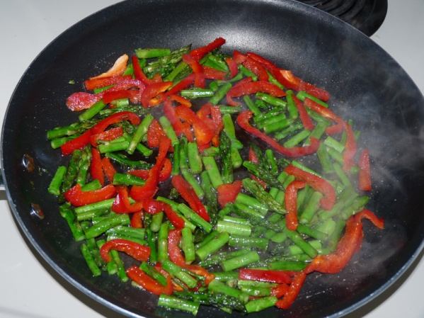 Saute asparagus and peppers