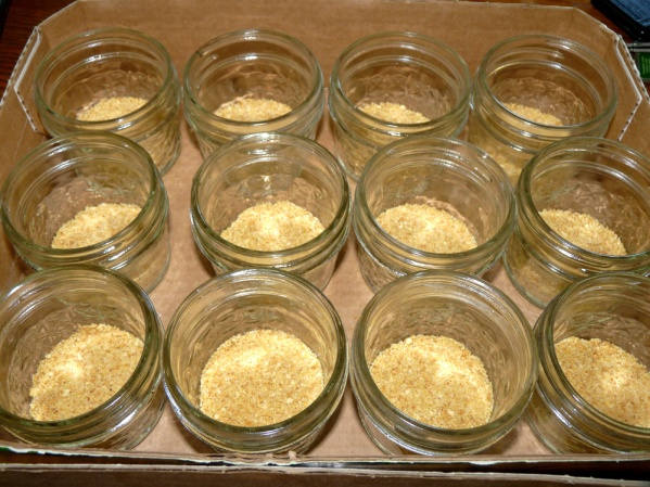 Press crumbs into the bottoms of half pint jars