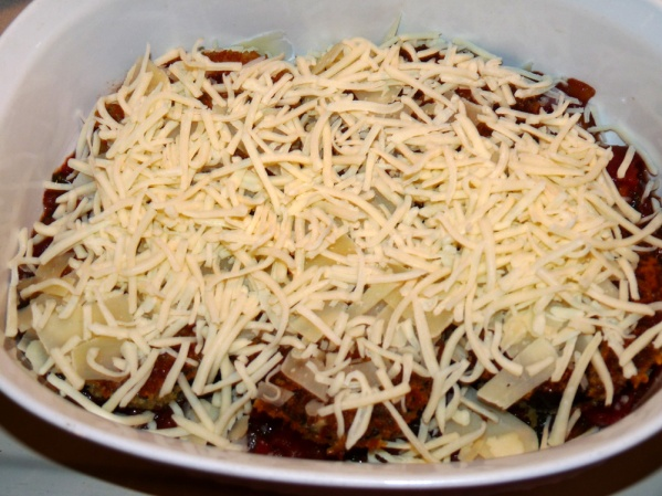 Place in ovenproof dish over a thin layer of marinara.  Add Parmesan and Monterey Jack and another layer of marinara
