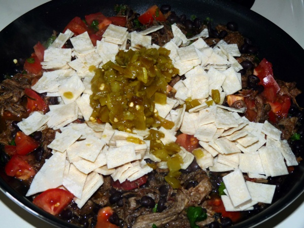 Add tortilla squares, small can of jalapenos and seasonings