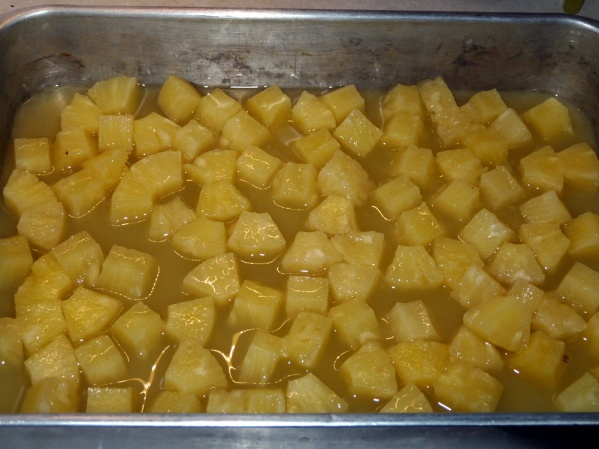 Dump cans of pineapple chunks and juice into a 9x13-in pan