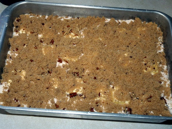 Slice buter and layer evenly over cake mix. Sprinkle brown sugar over the top