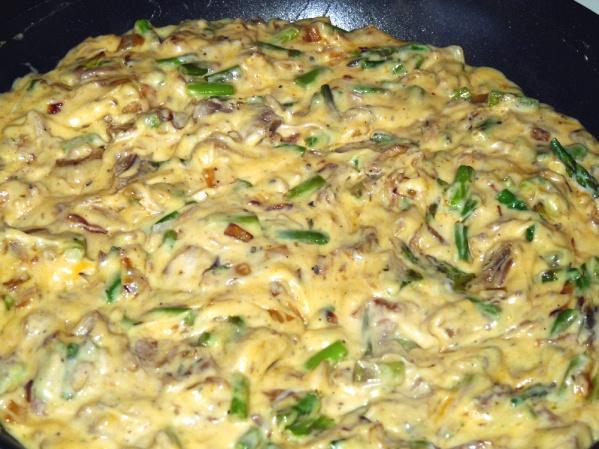 Add cream, milk, Parmesan and cheddar