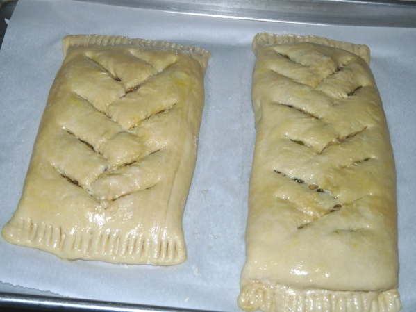 Make cuts in the bundles to serve as vents and baste with an egg wash