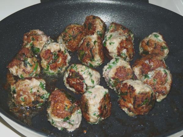 Turn meatballs until browned on several sides