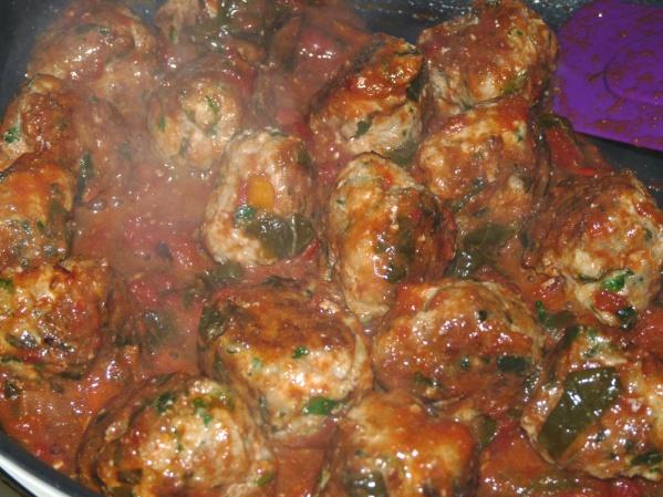 Add marinara sauce and reduce heat to medium low.  Simmer, adding water if necessary to prevent burning