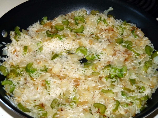 Saute onions and celery, then add rice and saute for a few more minutes