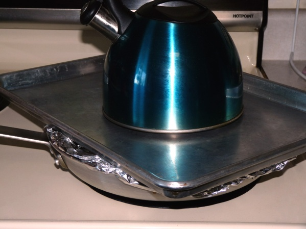 Cover tightly.  I used foil, a baking sheet and a tea kettle full of water to weight the baking sheet down!